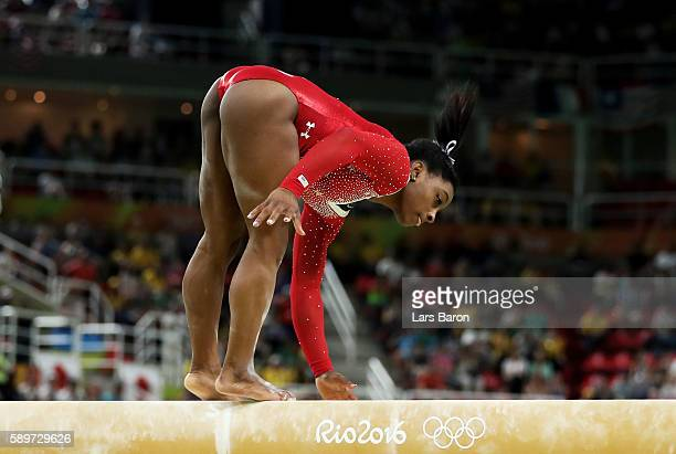 Simone Biles of the United States holds the beam with her hand while competing in the Balance Beam Final on day 10 of the Rio 2016 Olympic Games at...