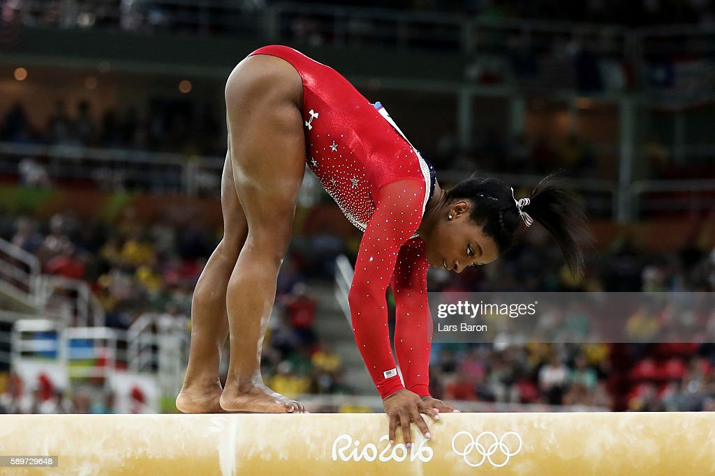 Simone Biles of the United States holds the beam with her hands while competing in the Balance Beam Final on day 10 of the Rio 2016 Olympic Games at Rio Olympic Arena on August 15, 2016 in Rio de Janeiro, Brazil.