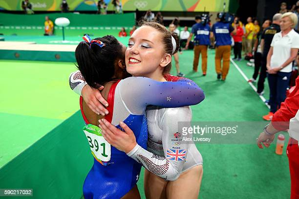 Simone Biles of the United States is embraced by Amy Tinkler of Great Britain after competing on the Women's Floor on the Women's Floor final on Day...