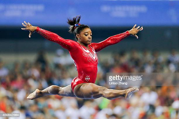Simone Biles of the United States performs on the Balance Beam during the Women's Team Final on day two of the 45th Artistic Gymnastics World...