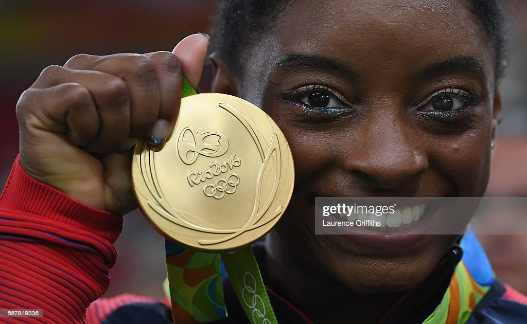 Simone Biles of the United States shows of her Gold medal after the Artistic Gymnastics Women's Team Final on Day 4 on Day 4 of the Rio 2016 Olympic Games at the Rio Olympic Arena on August 9, 2016 in Rio de Janeiro, Brazil.