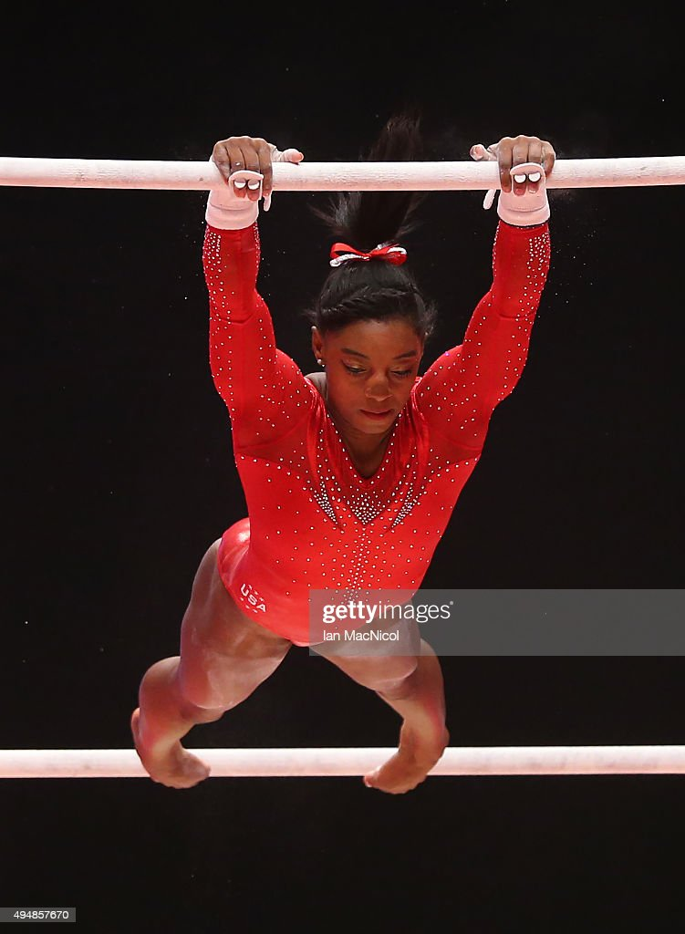 Simone Biles of the US competes on the Uneven Bars during day seven of World Artistic Gymnastics Championships at The SSE Hydro on October 29 2015 in...