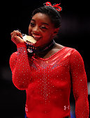 Simone Biles of the US poses with her Gold medal during day seven of World Artistic Gymnastics Championships at The SSE Hydro on October 29 2015 in...