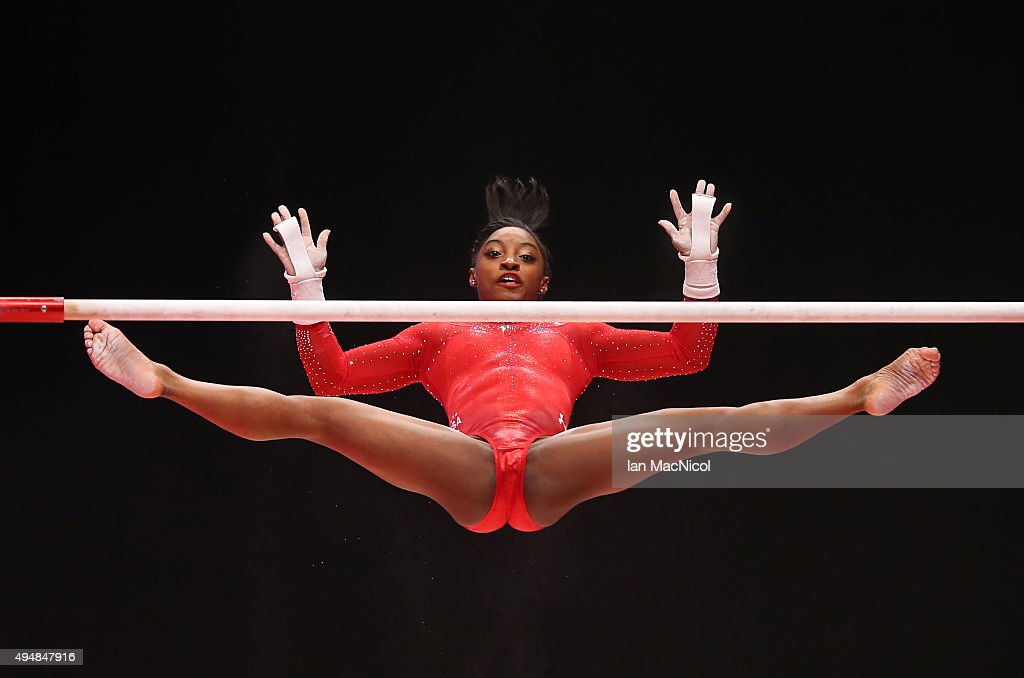 Simone Biles of United States competes on the Uneven Bars during day seven of World Artistic Gymnastics Championships at The SSE Hydro on October 29, 2015 in Glasgow, Scotland.