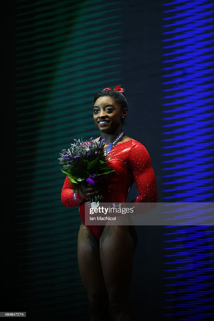 Simone Biles of United States poses with her Gold medal during day seven of World Artistic Gymnastics Championships at The SSE Hydro on October 29, 2015 in Glasgow, Scotland.