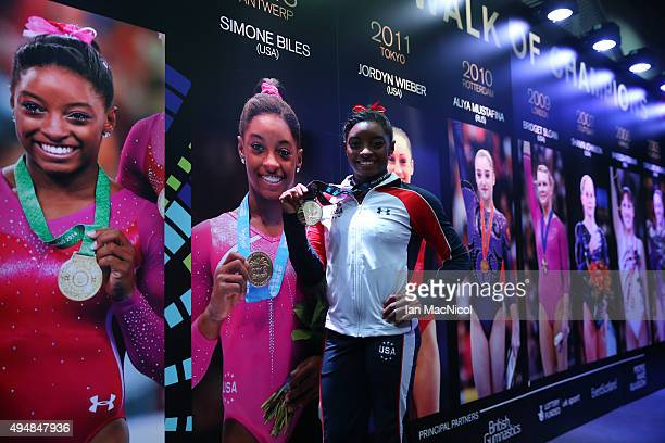 Simone Biles of United States poses with her Gold medal in the Hall of Champions during day seven of World Artistic Gymnastics Championships at The...