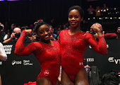 Simone Biles of USA and Gabrielle Douglas of USA celebrate after the AllAround Final on day seven of the 2015 World Artistic Gymnastics Championships...
