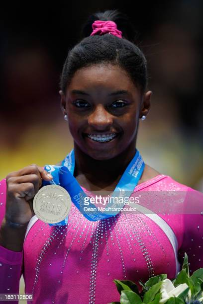 Simone Biles of USA poses after winning the Womens AllRound Final on Day Five of the Artistic Gymnastics World Championships Belgium 2013 held at the...