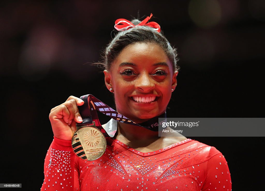 Simone Biles of USA poses with the Gold medal after winning the All-Around Final on day seven of the 2015 World Artistic Gymnastics Championships at The SSE Hydro on October 29, 2015 in Glasgow, Scotland.