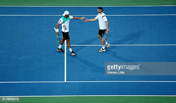 Simone Bolelli and Andreas Seppi of Italy in action against Feliciano Lopez and Marc Lopez of Spain in the men's doubles final of the ATP Dubai Duty...