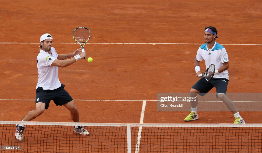 Simone Bolelli and Fabio Fognini of Italy in action against Andy Murray and Colin Fleming of Great Britain during day two of the Davis Cup World Group Quarter Final match between Italy and Great Britain at Tennis Club Napoli on April 5, 2014 in Naples, Italy.