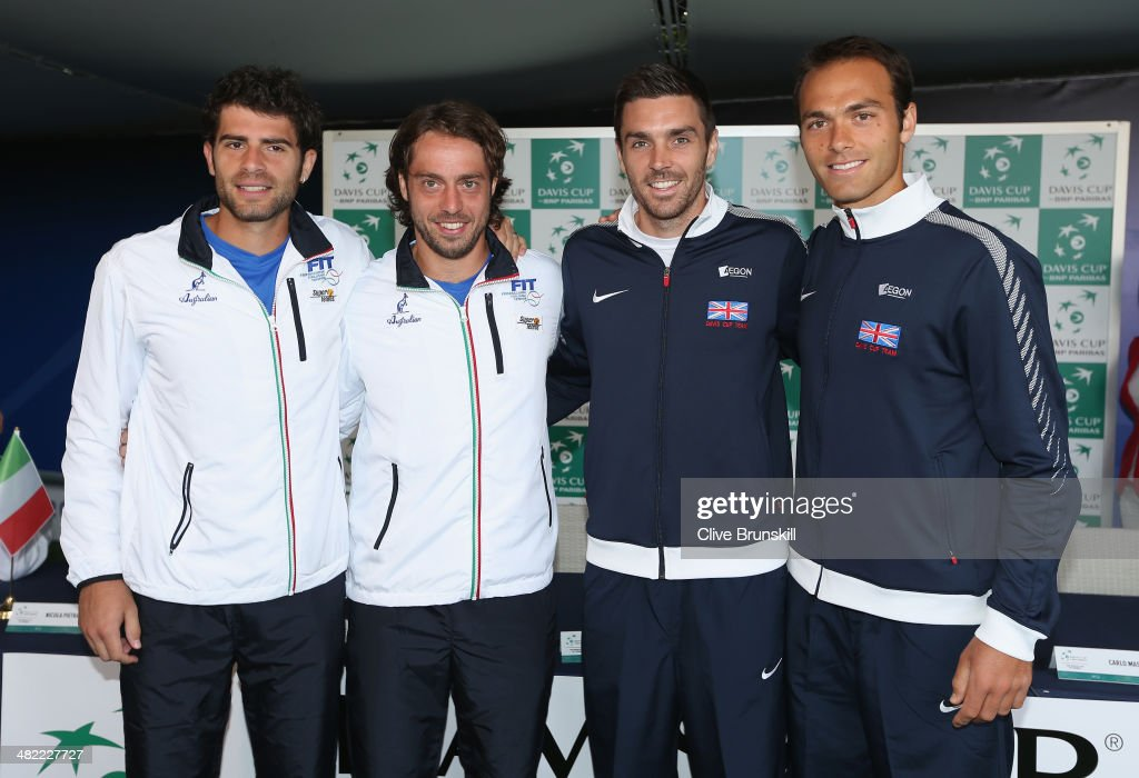 L-R <a gi-track='captionPersonalityLinkClicked' href=/galleries/search?phrase=Simone+Bolelli&family=editorial&specificpeople=553831 ng-click='$event.stopPropagation()'>Simone Bolelli</a> and Paolo Lorenzi of Italy pose for a photograph with Colin Fleming and Ross Hutchins of Great Britain prior to playing their doubles rubber on day 2 prior to the Davis Cup World Group Quarter Final match between Italy and Great Britain at Tennis Club Napoli on April 3, 2014 in Naples, Italy.