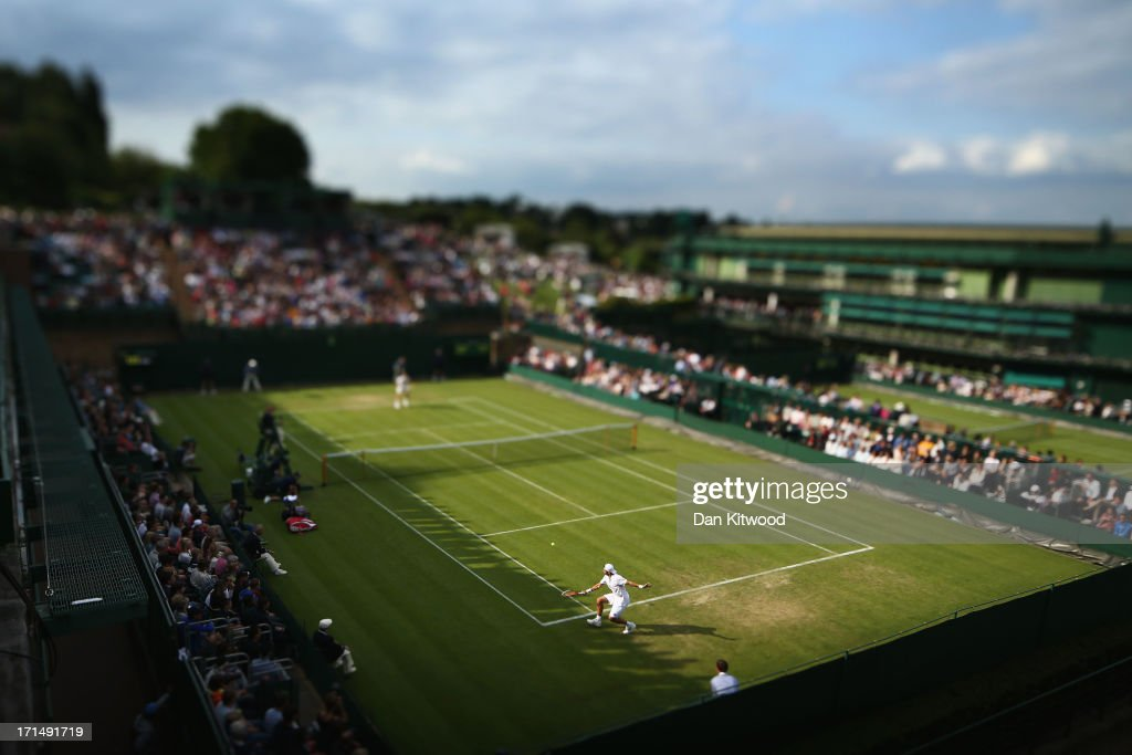 Simone Bolelli of Italy plays a backhand during his Gentlemen's Singles first round match against Grigor Dimitrov of Bulgaria on day two of the Wimbledon Lawn Tennis Championships at the All England Lawn Tennis and Croquet Club on June 25, 2013 in London, England.