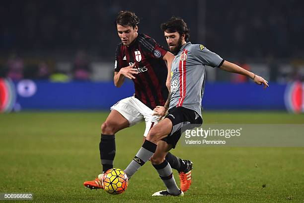 Simone Branca of US Alessandria competes with Andrea Poli of AC Milan during the TIM Cup match between US Alessandria and AC Milan at Olimpico...