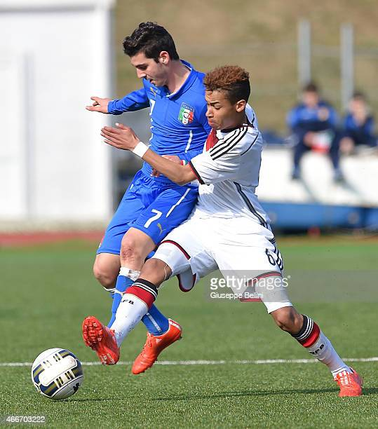 Simone Cantelli of Italy and Linton Maina of Germany in action during the international friendly match between U16 Italy and U16 Germany on March 18...