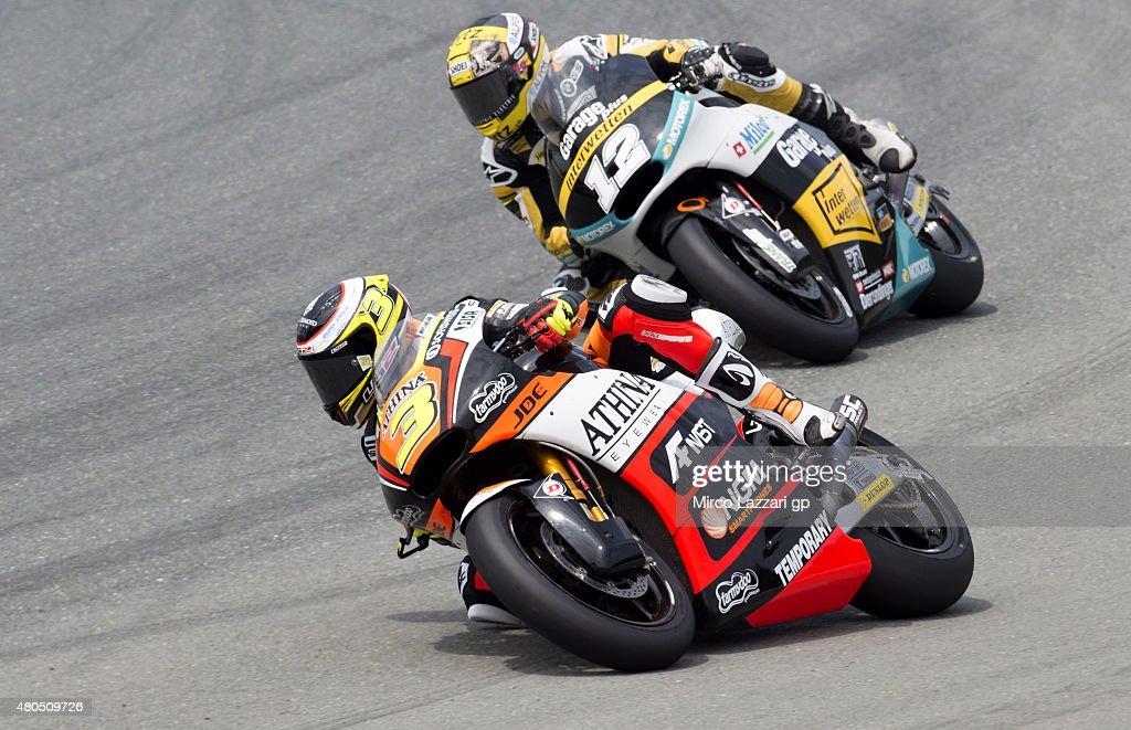 Simone Corsi of Italy and Athina Forward Racing leads Thomas Luthi of Switzerland and Derendinger Racing Interwetten during the Moto2 of Germany - Race at Sachsenring Circuit on July 12, 2015 in Hohenstein-Ernstthal, Germany.