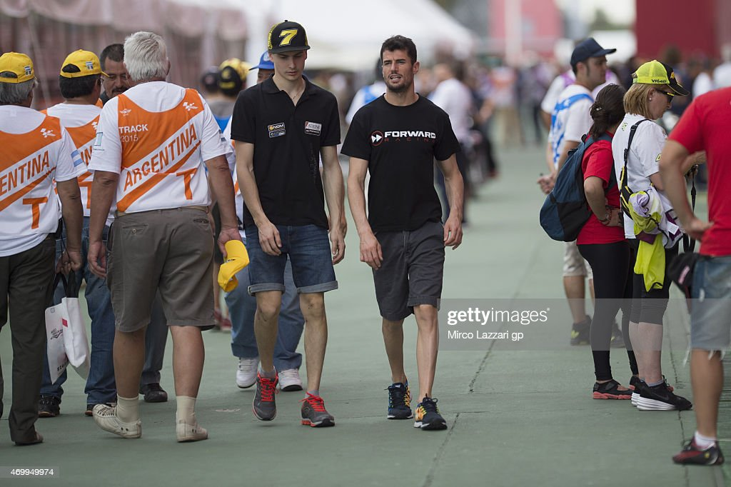 Simone Corsi of Italy and Forward Racing and Lorenzo Baldassarri of Italy and Forward Racing (L) walk in the paddock during the MotoGp of Argentina Preview at on April 16, 2015 in Rio Hondo, Argentina.