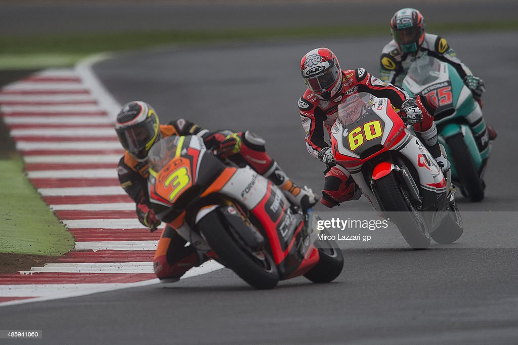 Simone Corsi of Italy and Forward Racing leads the field during the Moto2 race during the MotoGp Of Great Britain - Race at Silverstone Circuit on August 30, 2015 in Northampton, United Kingdom.
