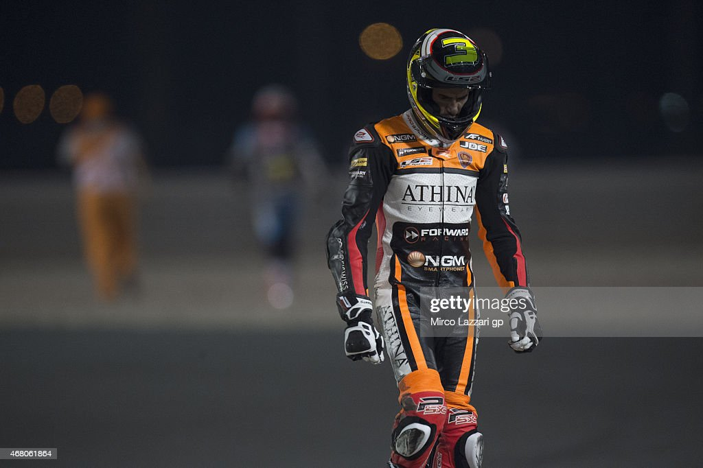 Simone Corsi of Italy and Forward Racing walks out of track after crashed out during the Moto2 race during the MotoGp of Qatar - Race at Losail Circuit on March 29, 2015 in Doha, Qatar.