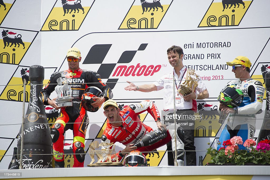 Simone Corsi of Italy and NGM Mobile Forward Racing; Jordi Torres of Spain and Aspar Team Moto2, Gino Borsoi of Spain and Pol Espargaro of Spain and Pons 40 HP Tuenti celebrate on the podium at the end of the Moto2 race during the MotoGp of Germany - Race at Sachsenring Circuit on July 14, 2013 in Hohenstein-Ernstthal, Germany.