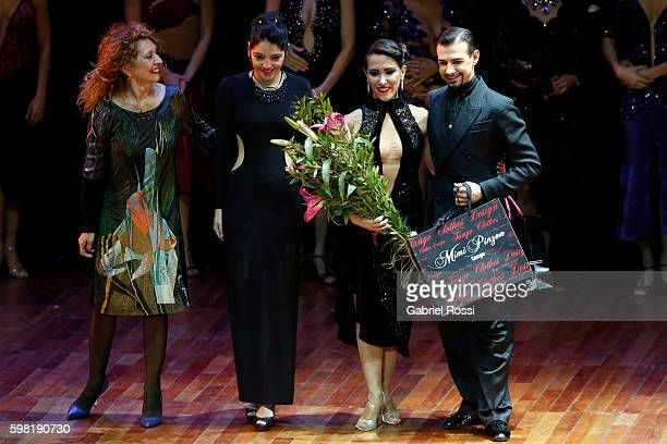 Simone Facchini and Gioia Abballe of Italy celebrate after winning the fourth place on the Stage Tango Final as part of Buenos Aires Tango Festival...