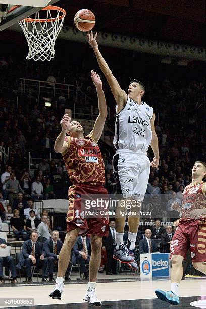Simone Fontecchio of Obiettivo Lavoro competes with Tomas Ress and Jeff Viggiano of Umana during the match of LegaBasket Serie A between Virtus...