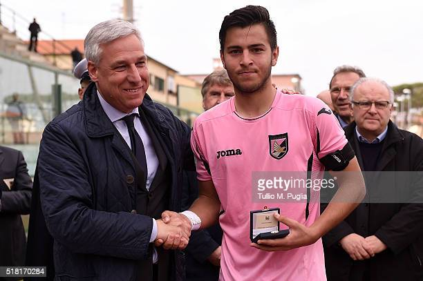 Simone Giuliano of Palermo is given an award during the Viareggio Juvenile Tournament match between FC Juventus and US Citta di Palermo on March 30...