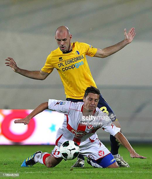 Simone Gozzi of Modena FC competes for the ball with Sasa Bjelanovic of AS Varese during the Serie B match between AS Varese and Modena FC at Stadio...