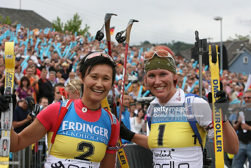 Simone Hauswald of Germany and Kati Wilhelm of Germany smile to the camera after the 6th ODLO City Biathlon on August 08 2010 in Puettlingen Germany