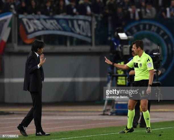 Simone Inzaghi head coach of SS Lazio and referee Gianluca Rocchi during the Serie A match between AS Roma and SS Lazio at Stadio Olimpico on...