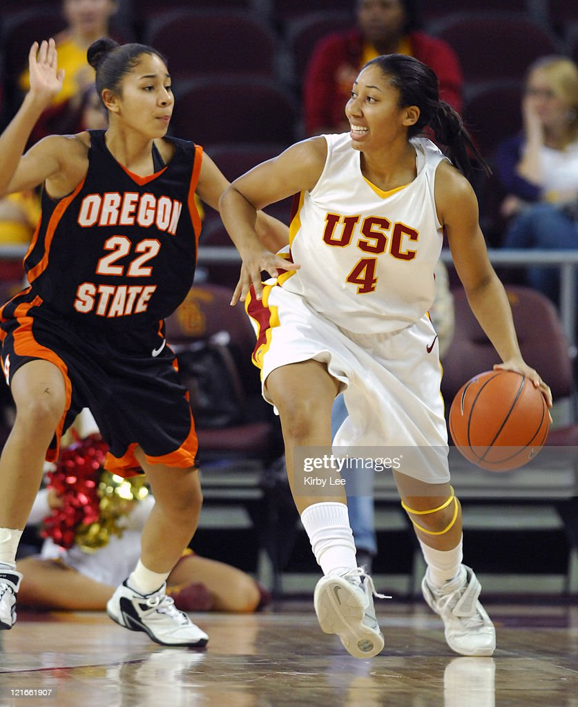 Simone Jelks of USC is defended by Jasmine Smith of Oregon State during Pacific10 Conference women's basketball game at the Galen Center in Los...