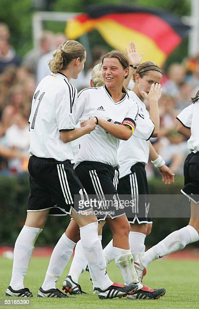 Simone Laudehr and Patricia Hanebeck celebrate Hanebeck's goal during their Under 19 friendly match v Norway on June 29 2005 in Wetzlar Germany