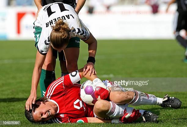 Simone Laudehr of Duisburg helps goalkeeper Nadine Angerer of Frankfurt during the Women's bundesliga match between FCR Duisburg and FFC Frankfurt at...