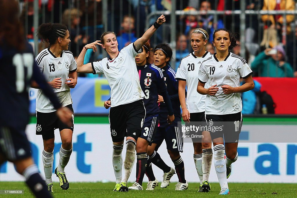 <a gi-track='captionPersonalityLinkClicked' href=/galleries/search?phrase=Simone+Laudehr&family=editorial&specificpeople=639251 ng-click='$event.stopPropagation()'>Simone Laudehr</a> of Germany celebrates her team's fourth goal with team mates during the Women's International Friendly match between Germany and Japan at Allianz Arena on June 29, 2013 in Munich, Germany.