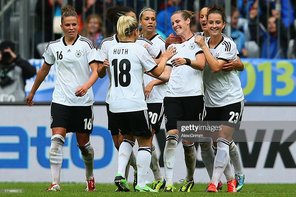 Simone Laudehr (3R) of Germany celebrates her team's fourth goal with team mates during the Women's International Friendly match between Germany and Japan at Allianz Arena on June 29, 2013 in Munich, Germany.