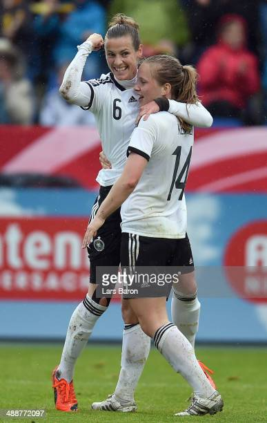 Simone Laudehr of Germany celebrates with team mate Tabea Kemme after scoring a goal during the FIFA Women's World Cup 2015 Qualifier between Germany...