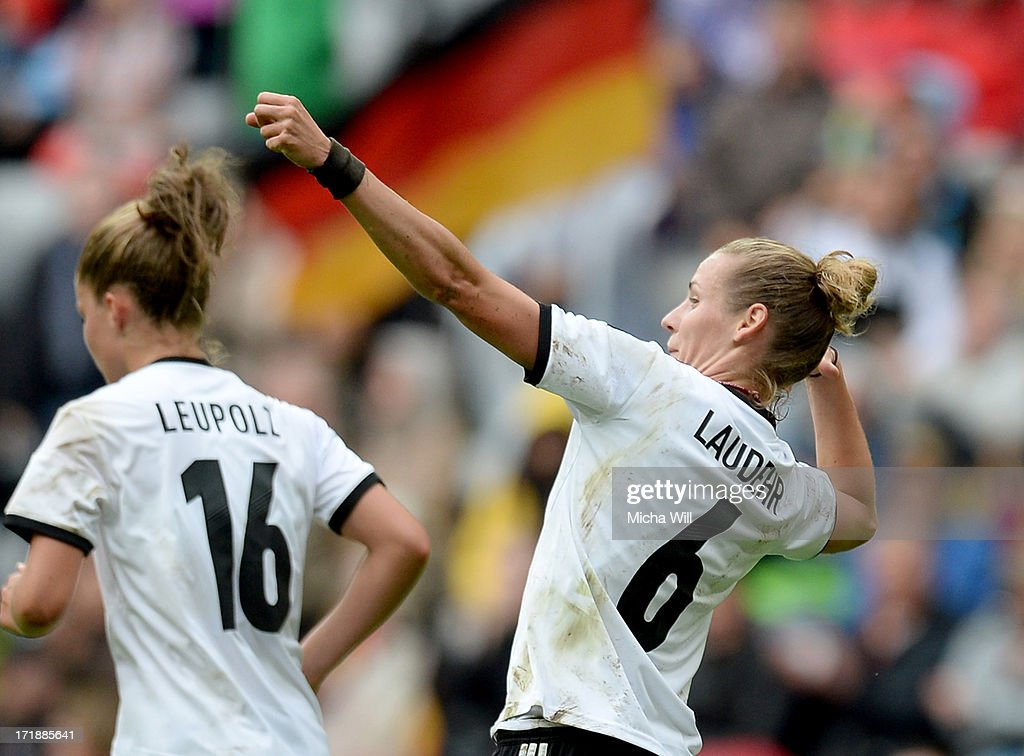 Simone Laudehr #62 of Germany celebrates with team mates after scoring her team's foruth goal during the Women's International Friendly match between Germany and Japan at Allianz Arena on June 29, 2013 in Munich, Germany.