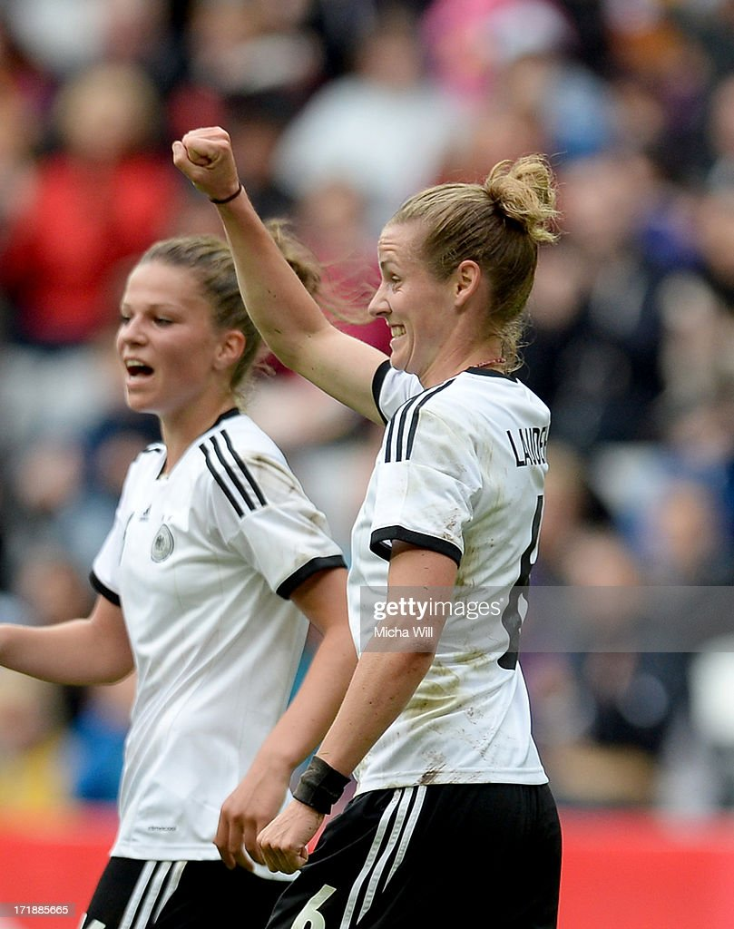 Simone Laudehr (R) of Germany celebrates with team mates after scoring her team's foruth goal during the Women's International Friendly match between Germany and Japan at Allianz Arena on June 29, 2013 in Munich, Germany.