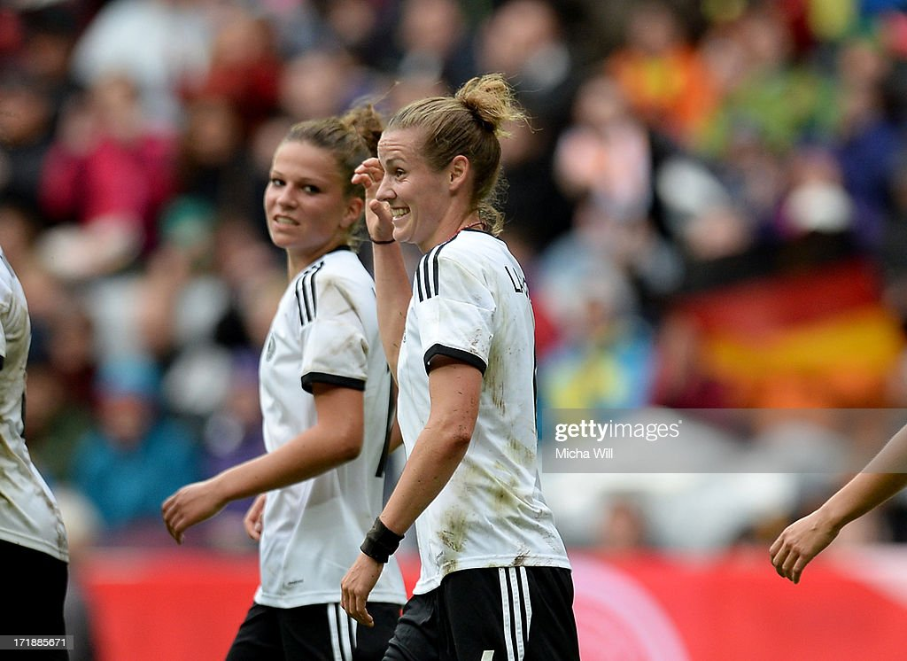 Simone Laudehr #6 of Germany celebrates with team mates after scoring her team's foruth goal during the Women's International Friendly match between Germany and Japan at Allianz Arena on June 29, 2013 in Munich, Germany.