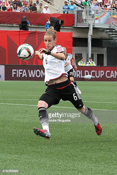 Simone Laudehr of Germany chases down the ball against Cote d'Ivoire during the FIFA Women's World Cup Canada 2015 Group B match between Germany and...