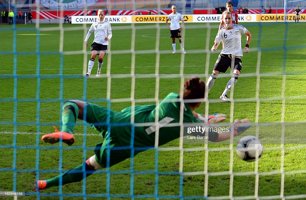 <a gi-track='captionPersonalityLinkClicked' href=/galleries/search?phrase=Simone+Laudehr&family=editorial&specificpeople=639251 ng-click='$event.stopPropagation()'>Simone Laudehr</a> of Germany scores his teams third goal from the penalty spot during the UEFA Womens Euro 2013 qualification match between Germany and Turkey at Schauinsland-Reisen-Arena on September 19, 2012 in Duisburg, Germany.