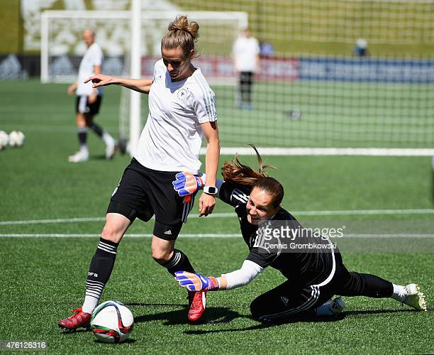 Simone Laudehr of Germany vies past goalkeeper Laura Benkarth during a training session ahead of their Group B match against Cote d'Ivoire at...