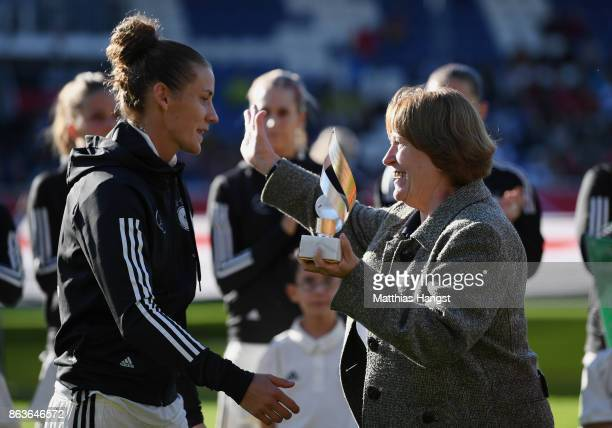 Simone Lauder is honored by DFB Vice President Hannelore Ratzeburg for their 100th national team match prior to 2019 FIFA Women's World Championship...