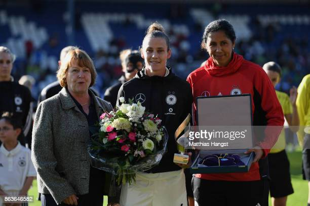 Simone Lauder is honored by DFB Vice President Hannelore Ratzeburg and Head coach Steffi Jones of Germany for their 100th national team match prior...