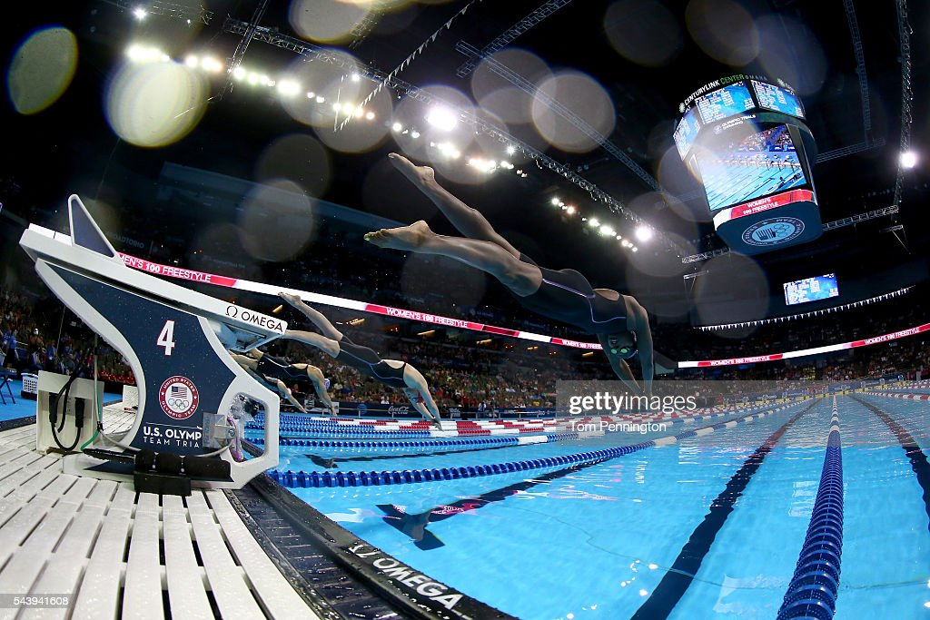 <a gi-track='captionPersonalityLinkClicked' href=/galleries/search?phrase=Simone+Manuel&family=editorial&specificpeople=10964803 ng-click='$event.stopPropagation()'>Simone Manuel</a> (R) and <a gi-track='captionPersonalityLinkClicked' href=/galleries/search?phrase=Katie+Ledecky&family=editorial&specificpeople=9595921 ng-click='$event.stopPropagation()'>Katie Ledecky</a> (L) of the United States dive in to compete in a heat for the Women's 100 Meter Freestyle during Day Five of the 2016 U.S. Olympic Team Swimming Trials at CenturyLink Center on June 30, 2016 in Omaha, Nebraska.
