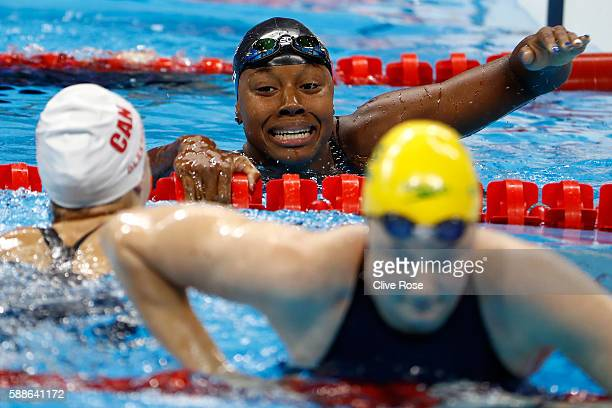 Simone Manuel of the United States and Penny Oleksiak of Canada celebrate winning joint gold in the Women's 100m Freestyle Final on Day 6 of the Rio...