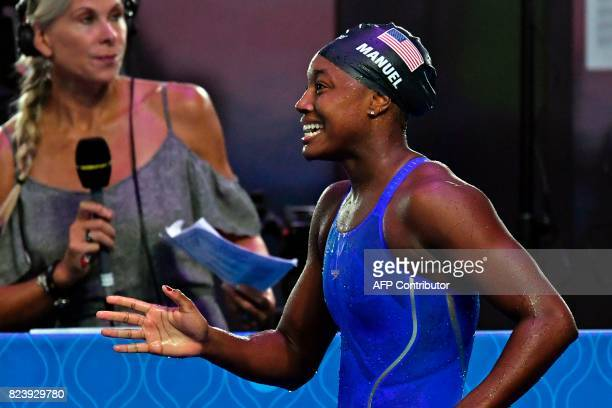 US Simone Manuel reacts after competing in the women's 100m freestyle final during the swimming competition at the 2017 FINA World Championships in...
