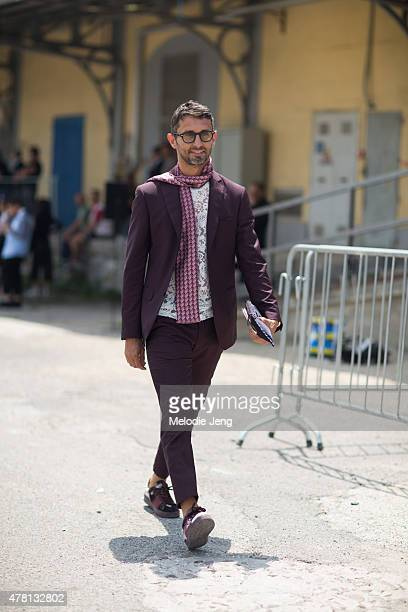 Simone Marchetti enters the Gucci show in a Pal Zileri and Valentino shoes on June 22 2015 in Milan Italy