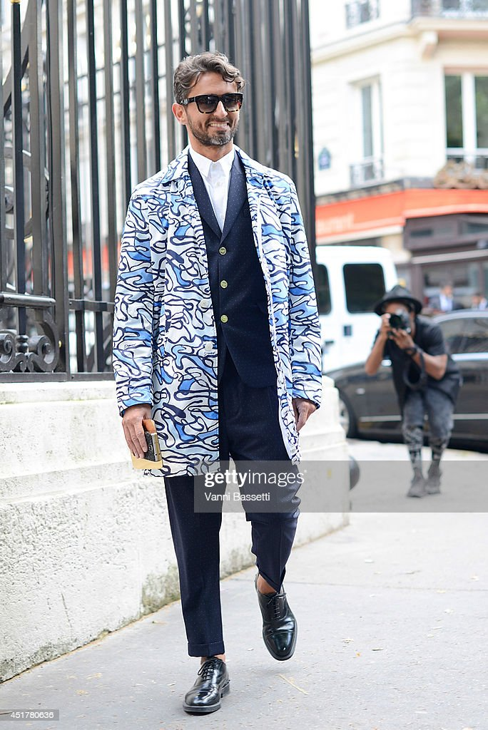 Simone Marchetti poses wearing a Dsquared outfit before Atelier Versace show on July 6, 2014 in Paris, France.