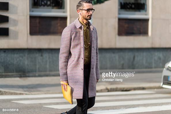 Simone Marchetti wearing a checked coat outside Max Mara during Milan Fashion Week Fall/Winter 2017/18 on February 23 2017 in Milan Italy